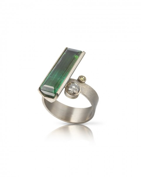 On the slant bluw green tourmaline ring.1