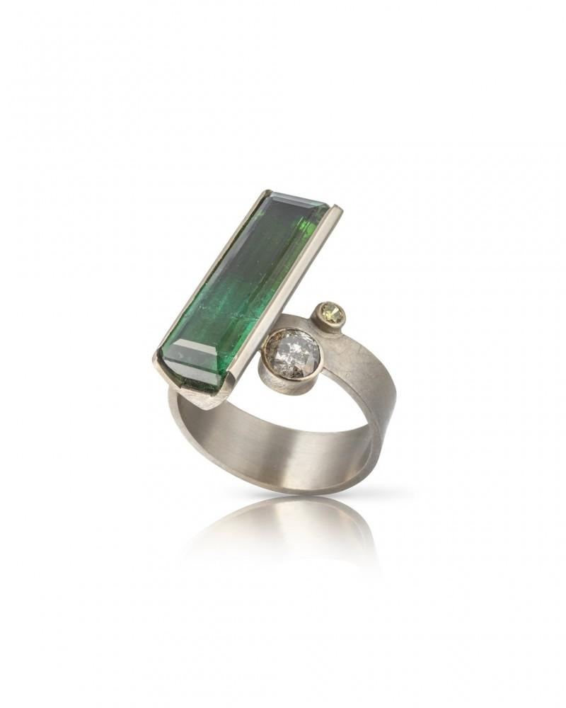 On the slant bluw green tourmaline ring.1